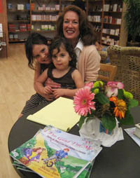 Sheila with two girls at book signing/reading.