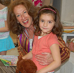 Sheila Aron, author, at Haar Hasholom with girl in lap.