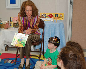 Sheila Aron, author, reading to children.