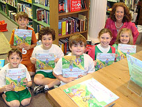 Sheila Aron with kids holding books after book reading.